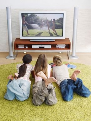 Three children watching TV